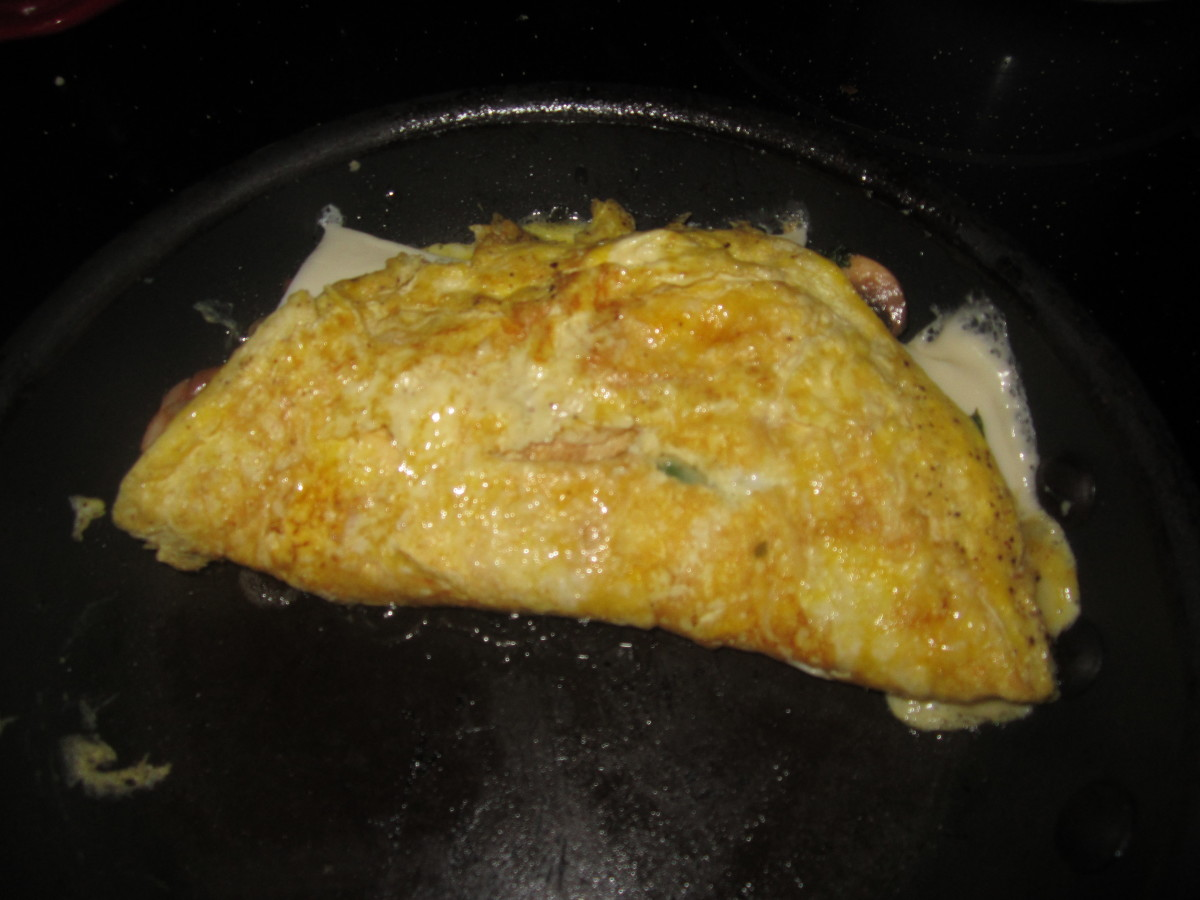 Sometimes folding the omelet can be tricky. What I do is load the filling on one side of the omelet. That way, you can easily get your spatula under the empty side to fold it over.