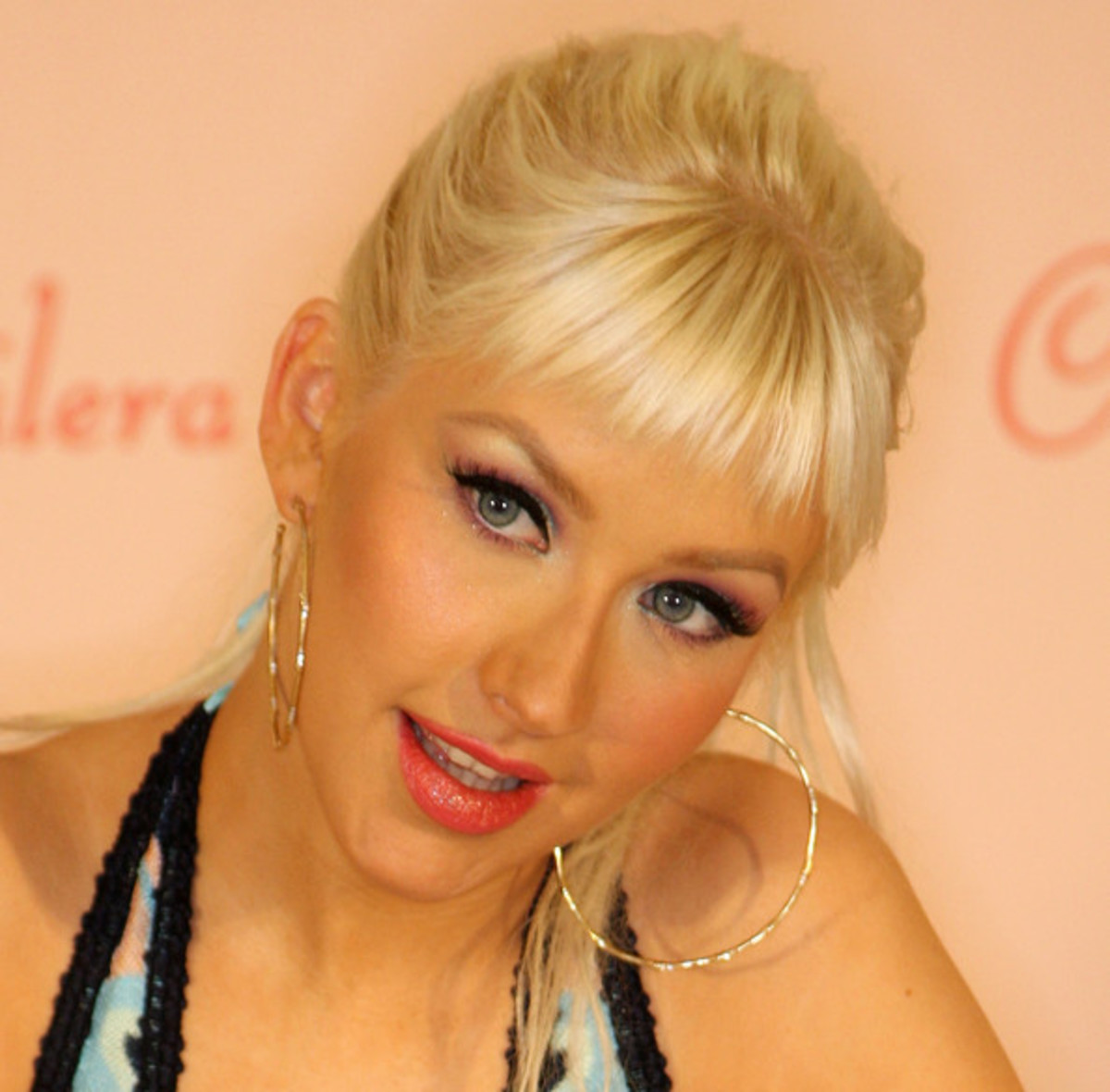 "6. Christina Aguilera. I've known her having a blonde-white hair. I like her ""Reflection"" song ."