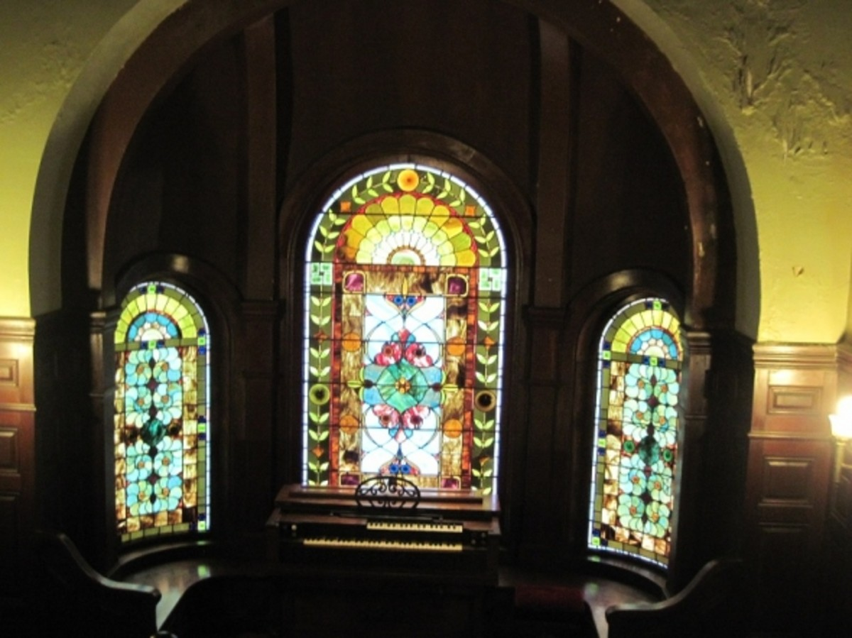 Wilson Castle main staircase landing, organ and stained glass windows