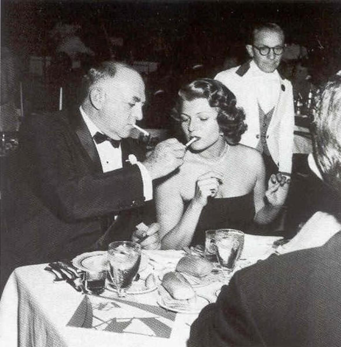 Cohn with Rita Hayworth
