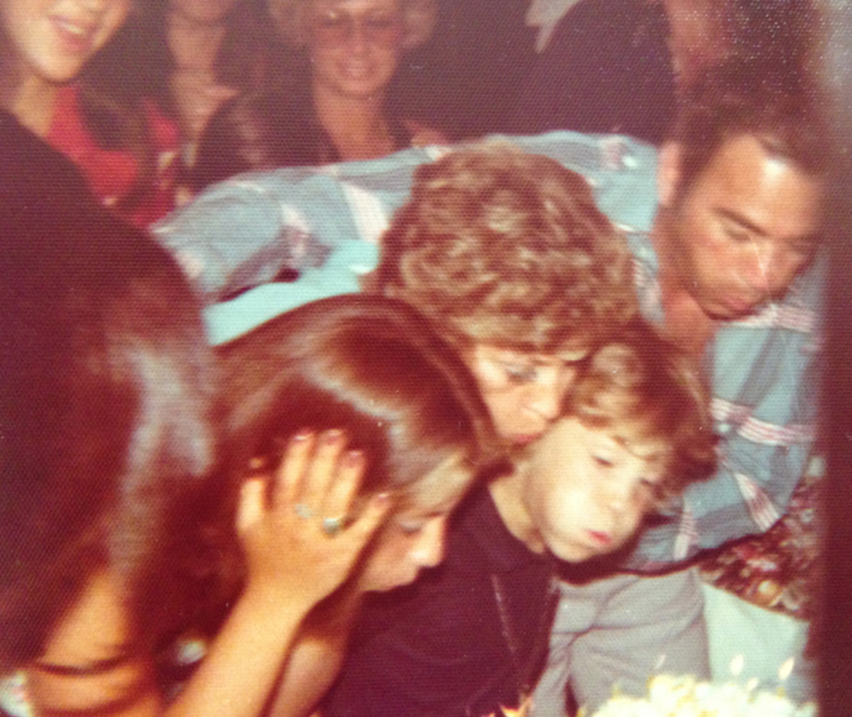 My sweet sixteen Peter helping me bow out the candles. 1974