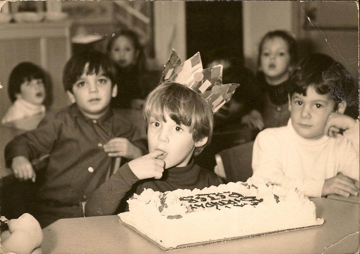 Peter Kellerman as a boy in elementary school, enjoying his birthday cake
