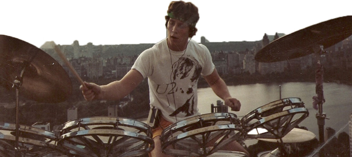 Peter Kellerman one fine day playing the drums on a Rooftop in New York City