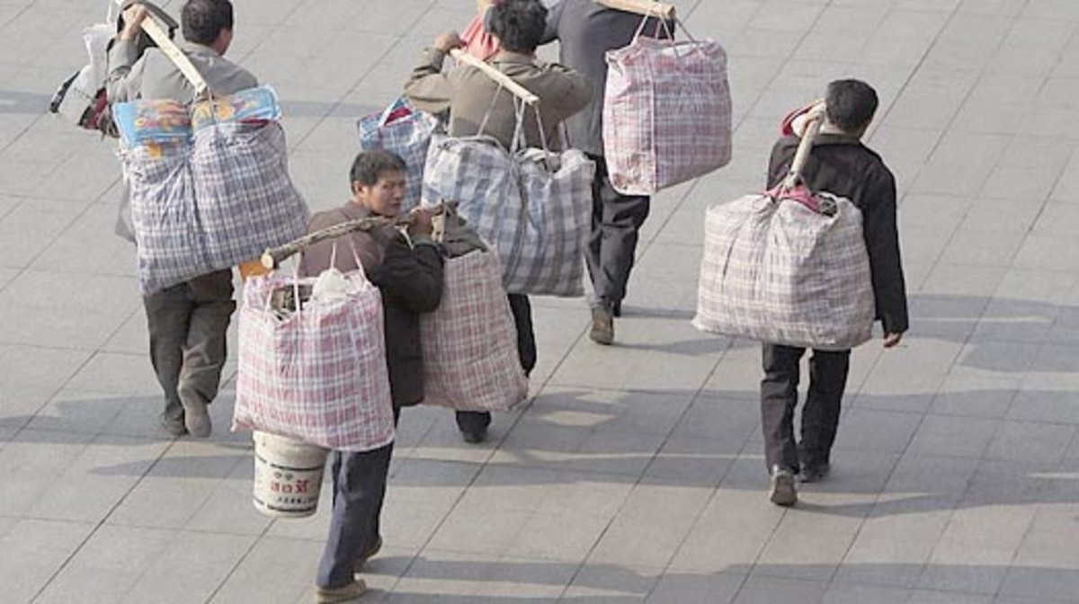 "China has 225 million rural born migrant workers in the cities.Living in crowded dormitories, they  and their children are not entitled to health care, education or pensions in the city because their ""hukou""(residence registration) is elsewhere."