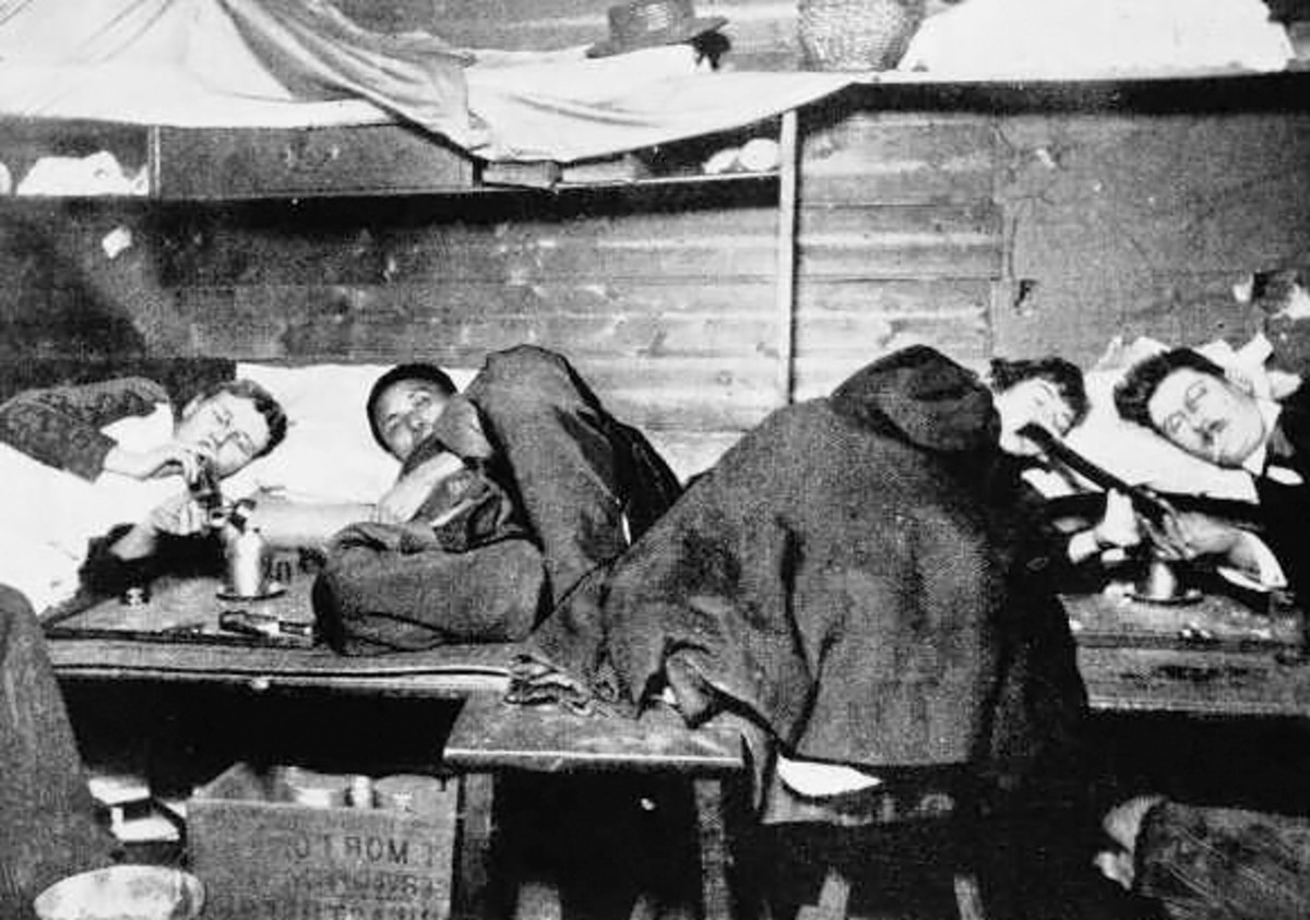 In a Chinese opium den.Foreigners among Chinese users (circa 1890)