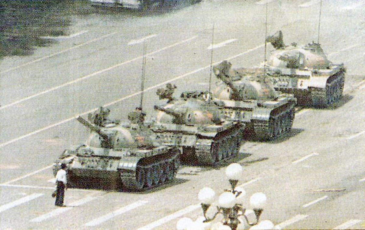 "Tianamen,Beijing,China June 5,1989, An ordinary anonymous Chinese ""The Unknown"" stand defiant in front of a column of tanks sent to disperse Chinese students and workers protesting authoritarian rule"