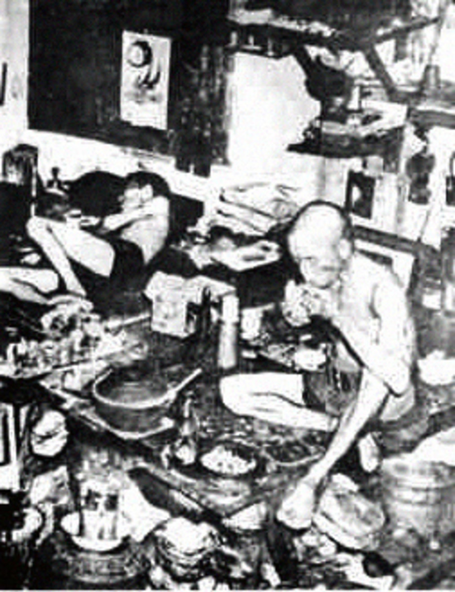 In the squalor of an opium den.Emaciated addicts living only for the next fix (circa 1890)