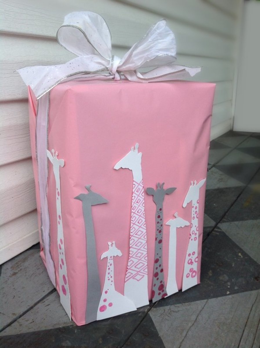 This super adorable giraffe-themed gift wrap will be a major hit at a baby shower.