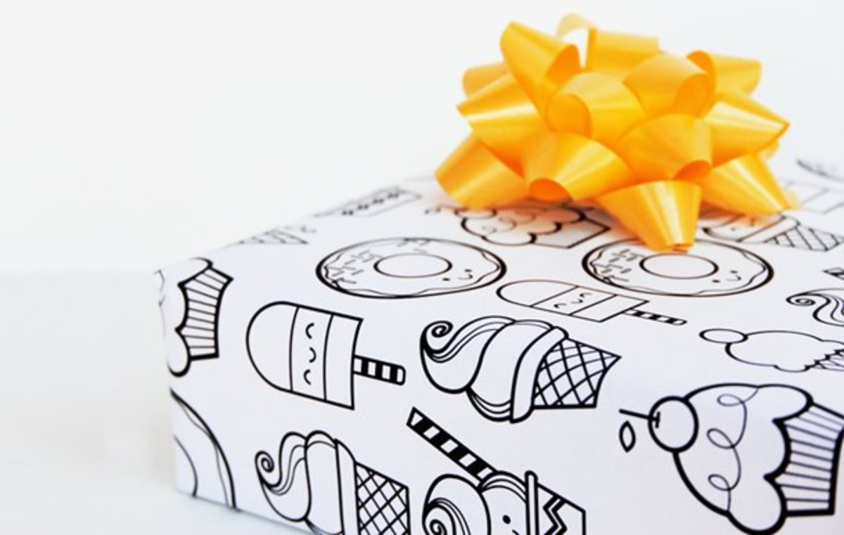 Cover your kid's present with coloring book pages to make it even more fun.