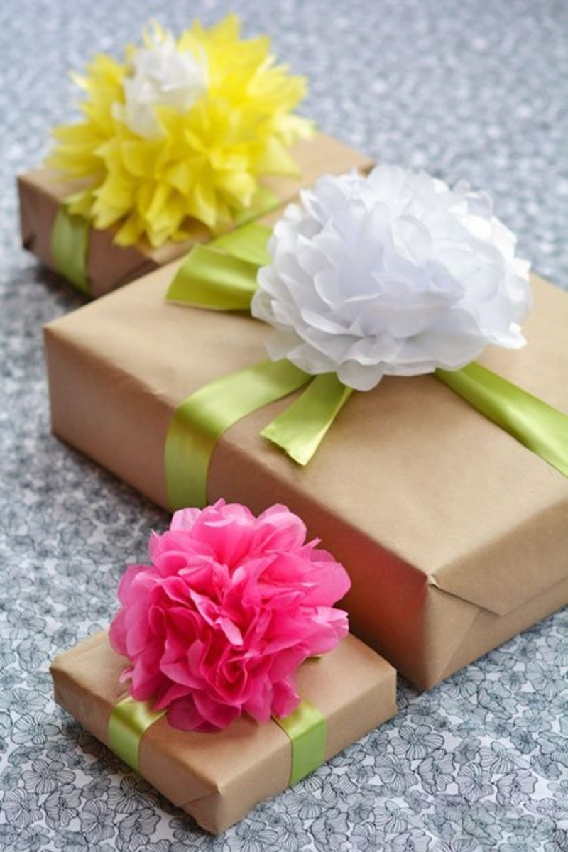 DIY tissue paper flower toppers for Mother's Day gifts.