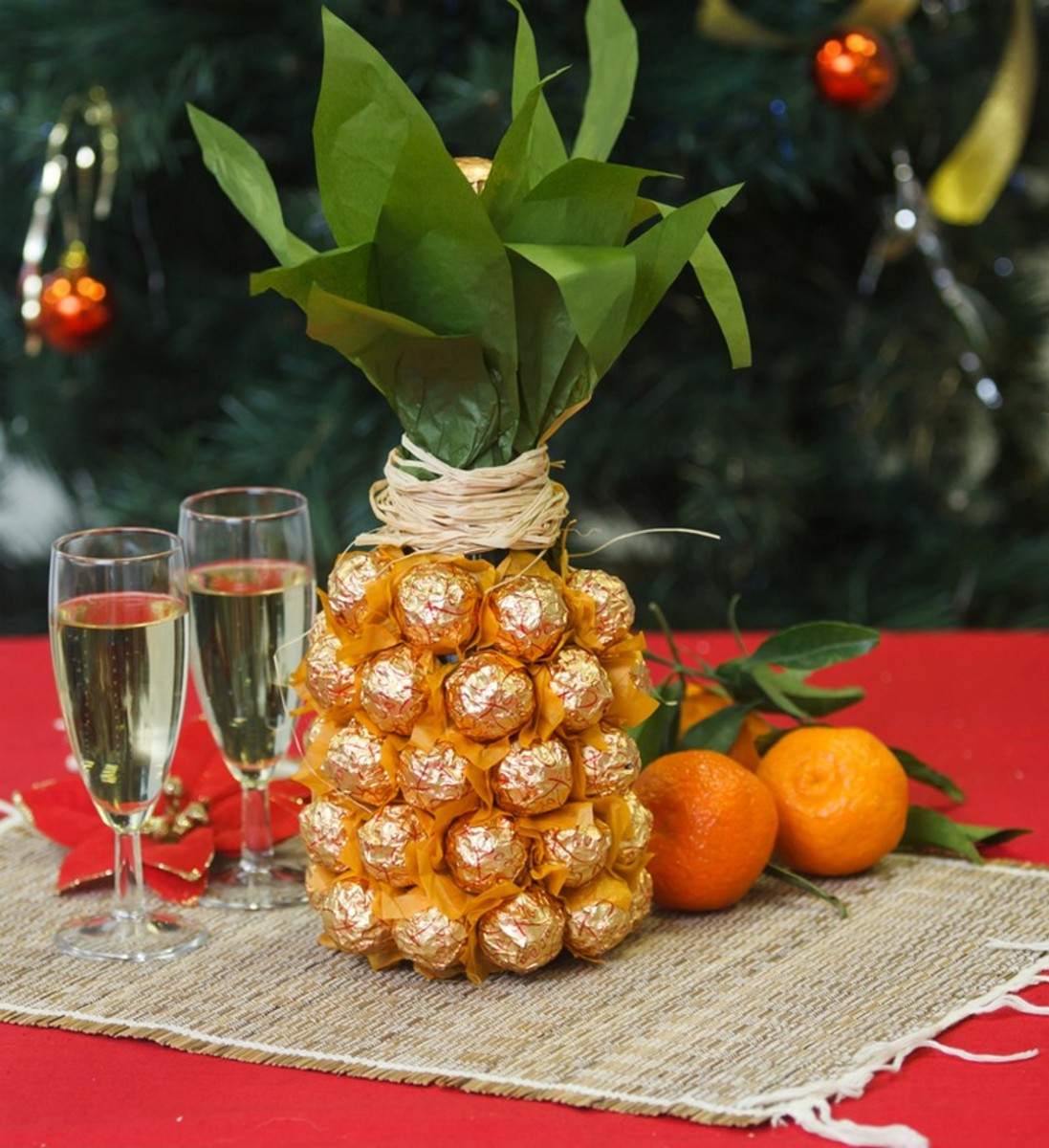 Bottle of champagne covered with Ferrero Rocher candy makes an awesome hostess gift.