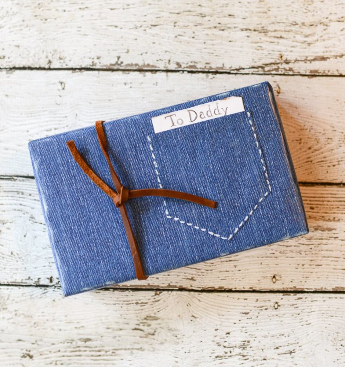 Father's Day gift wrapped in denim paper with leather twine.