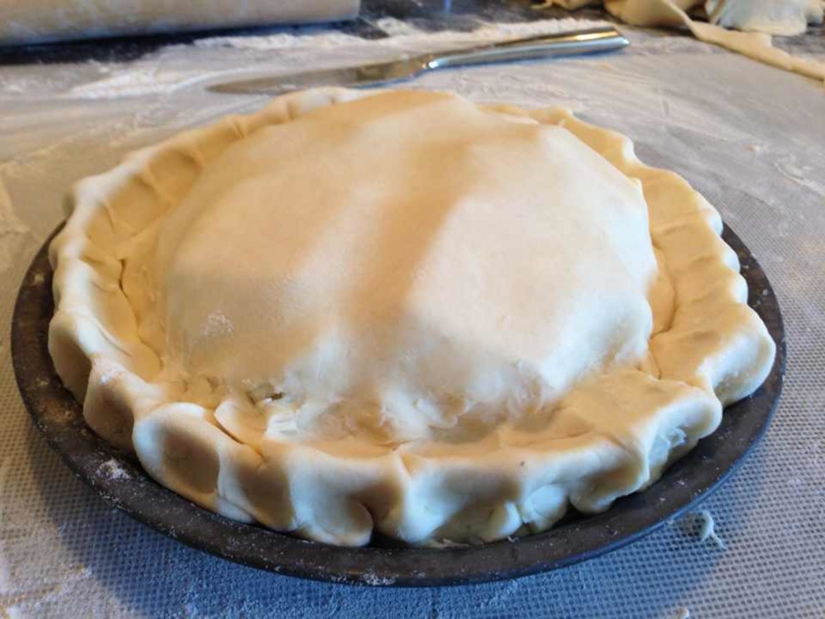 Pie dough crimped to make beautiful looking crust