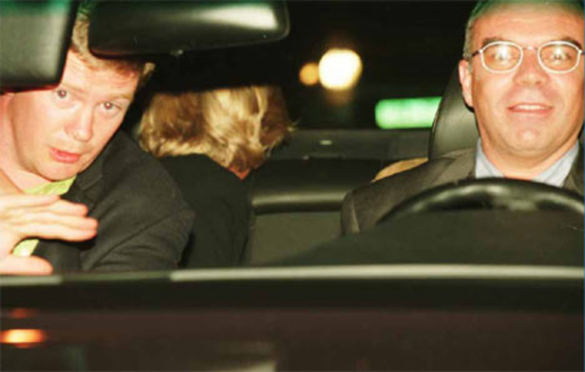 Princess Diana in the black Mercedes looks behind her just moments before the crash. The driver and bodyguard are in the front