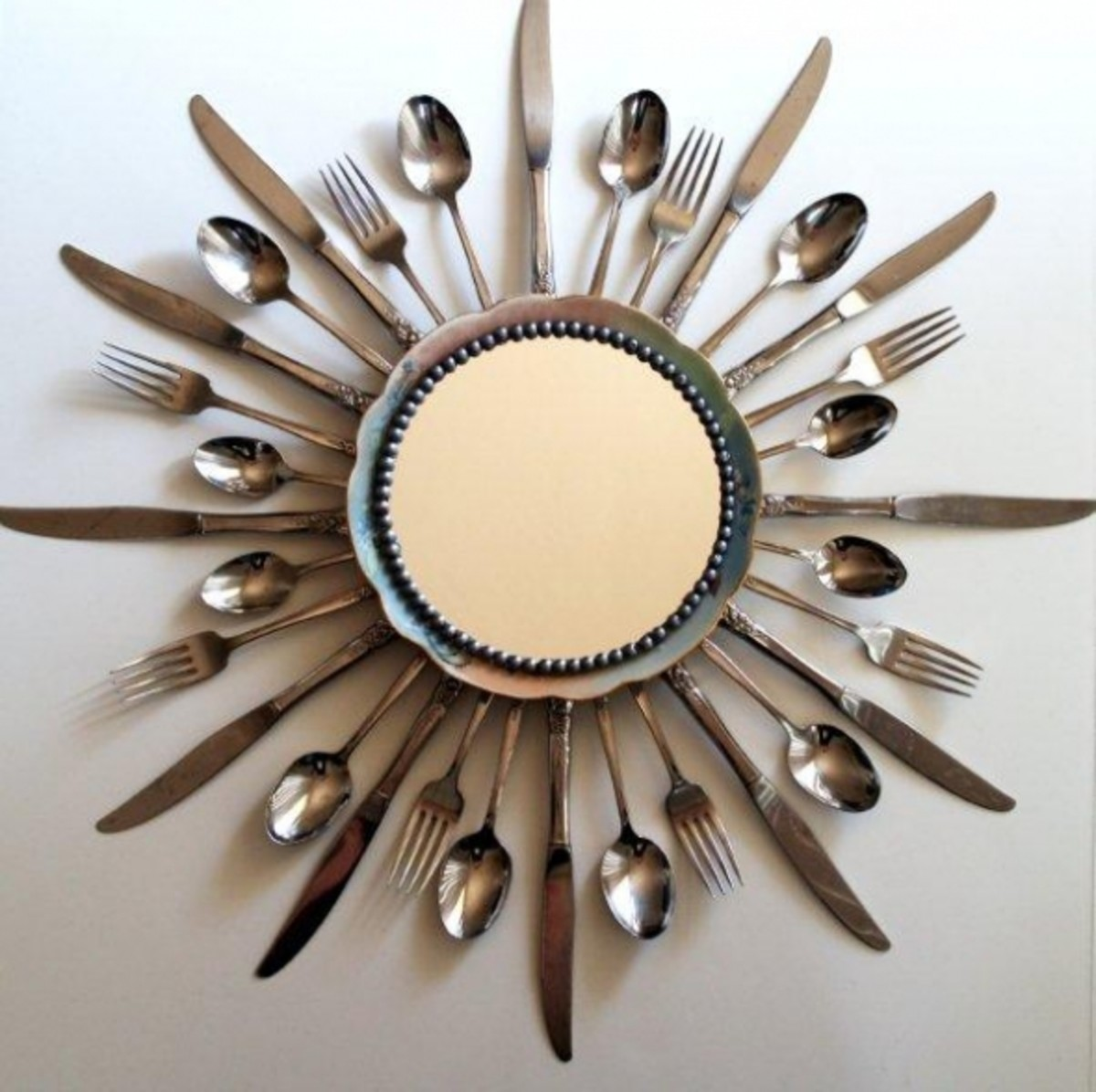 Silverware mirror made by Beverly at FlamingoToes.com. See the link below for instructions on making your own.
