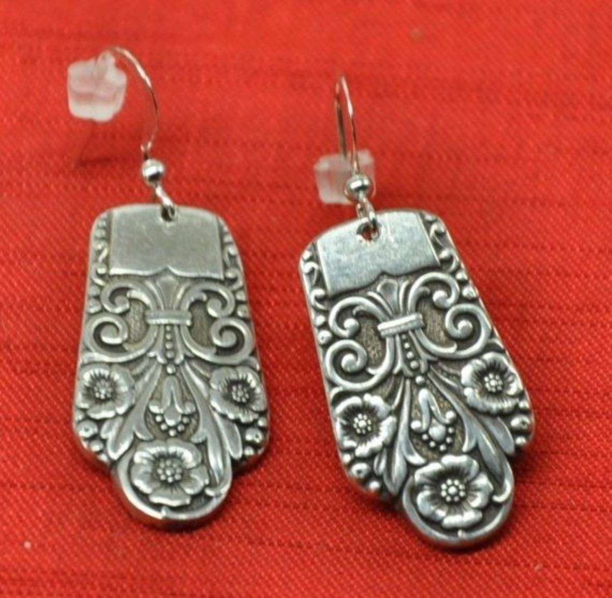 Earrings made from ends of silver spoons. Made by jjevensen. See link below to view these on Etsy.