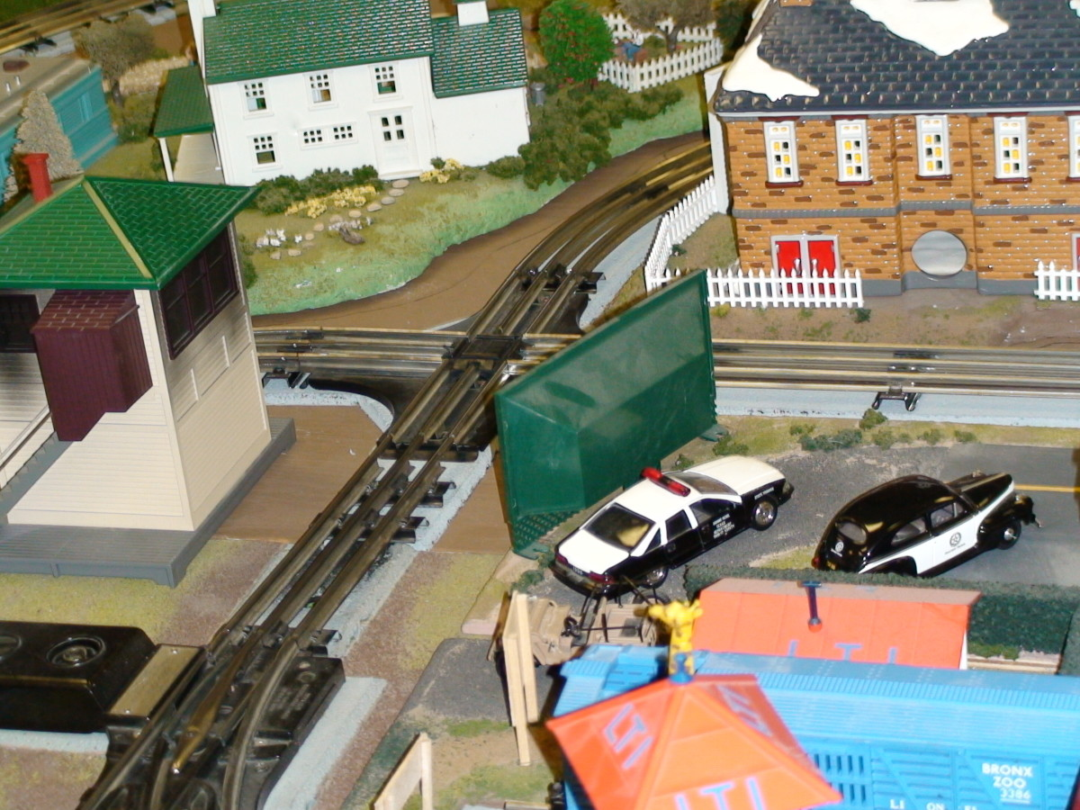 the scale of layout accessories must mach the model train scale.