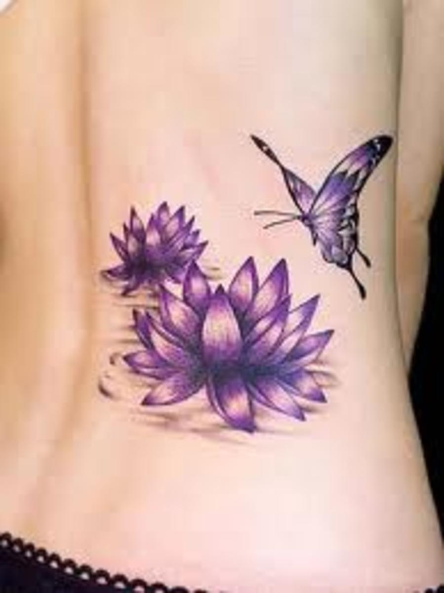 The flowers add a landscape for the primary tattoo.