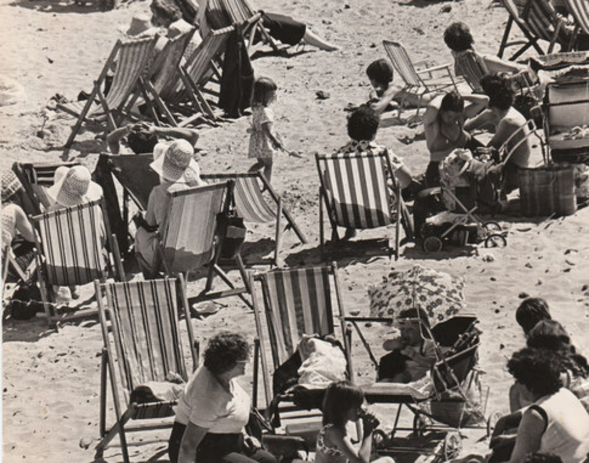 Redcar Beach 'under siege', deckchairs as far as the eye can see, Candy Floss vendors, tea stalls, ice cream sellers, donkey rides along the tide line, Punch & Judy shows (at least two) and people tramping up and down looking for family or friends