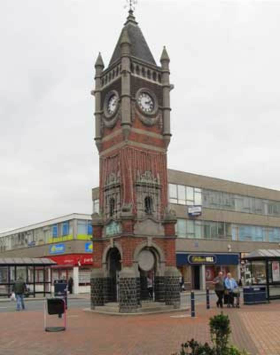 The King Edward VII Memorial clocktower stands at one end of the High Street...