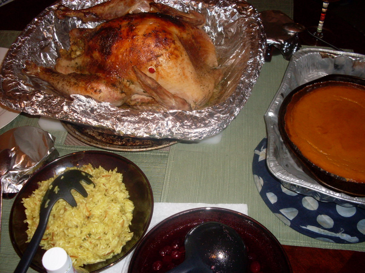 whole turkey, rice, cranberry sauce and pie