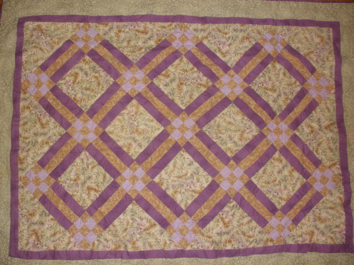 This traditional quilt uses rail fence blocks and nine patch blocks in a diagonal setting.