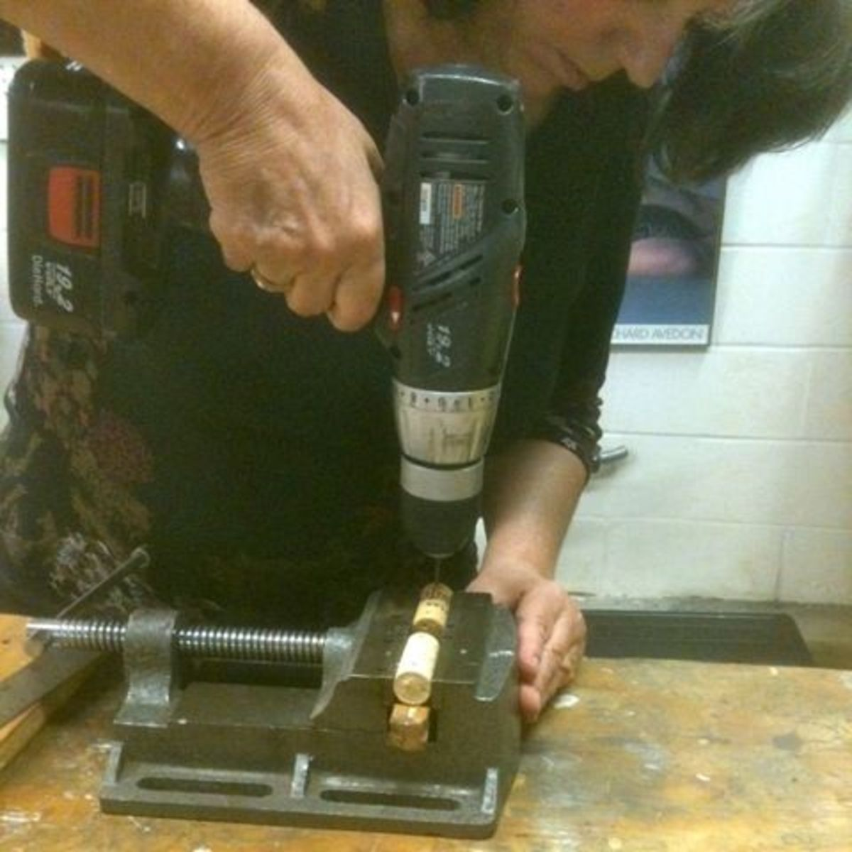 Mickie_G drilling the wine corks with a drill