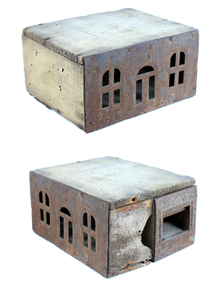 Air holes cut in the shape of little windows. Not very effective since mice were able to chew through the side of the trap. BUT CAN BE CONVERTED INTO A DOLL HOUSE FOR PLAYTIME.