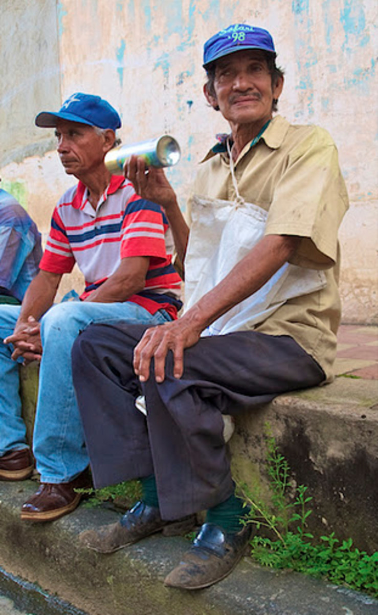 The paint can shaker of the band on the street. Diriamba, Nicaragua