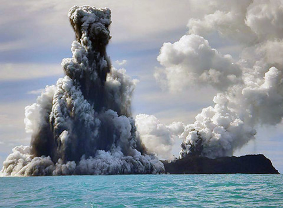 Clouds of ash surge into the air following an underwater volcano explosion