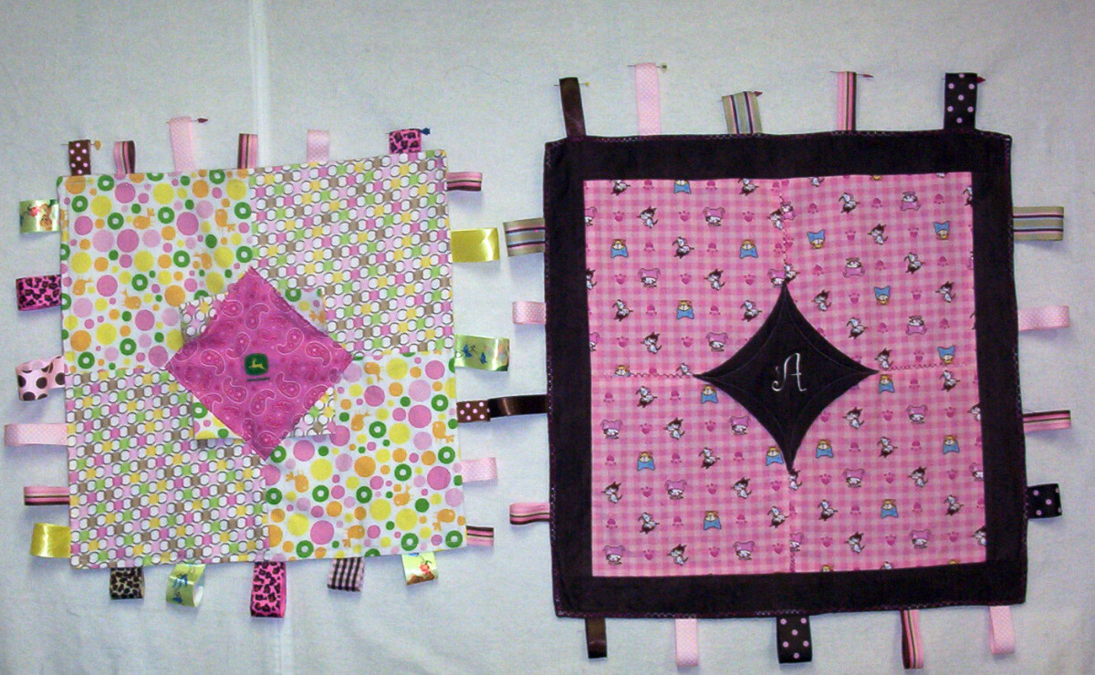Both blankets have the10-minute block in the center but the pink one on the left has pockets.  These were made using prairie points.  I used one of the tricks she showed in the short video to get the pointed look in the embroidered block.