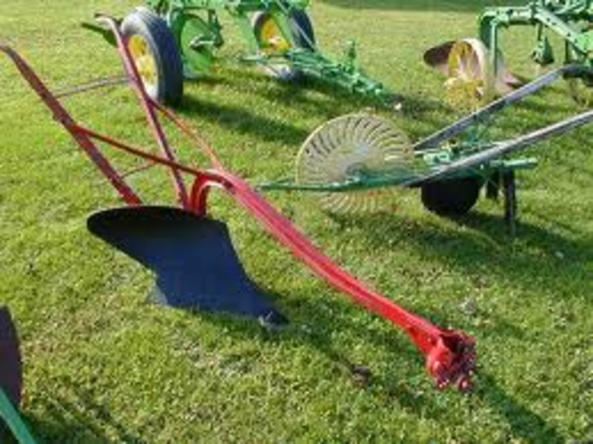 Some types of horse drown ploughs and other earth turning device.