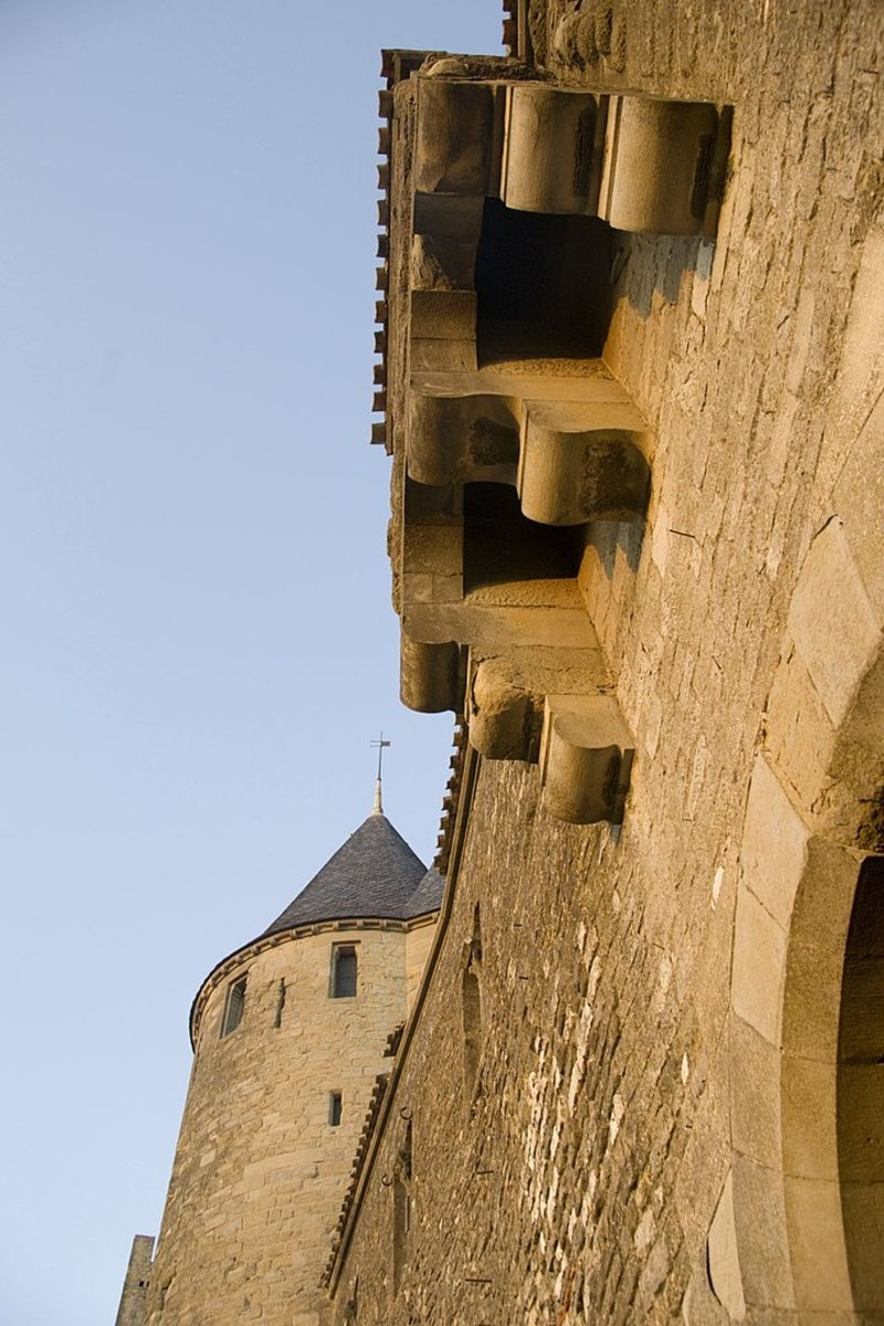 These holes above the gate of this medieval castle are toilets right above the gate. I might have to find another gate.