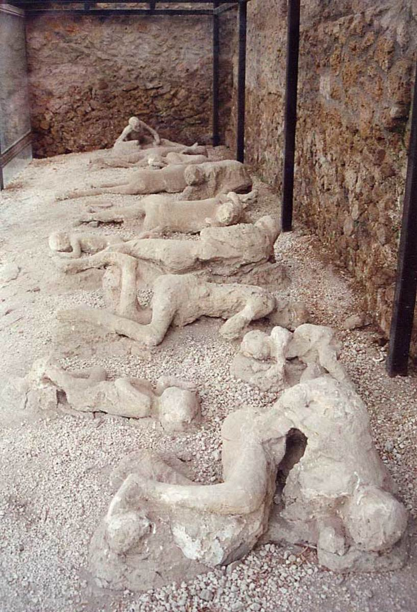"""The casts of the corpses of a group of human victim of the 79 AD eruption of the Vesuvius, found in the so-called """"Garden of the fugitives"""" in Pompeii."""