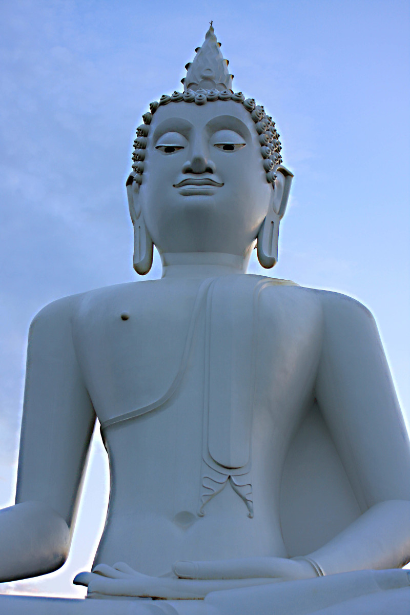 A giant Buddha statue on a hill-top