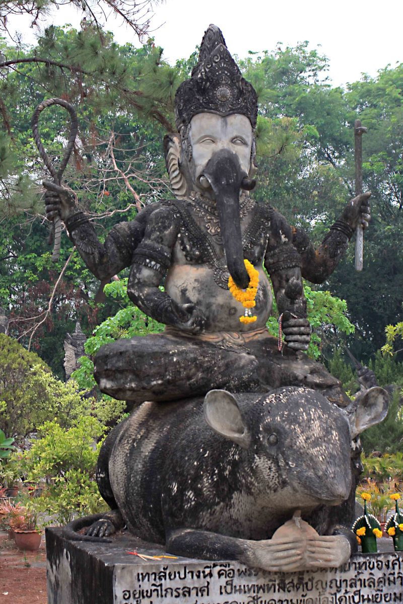 Hindu God Ganesh rides his traditional mount, here depicted as a mouse or rat !