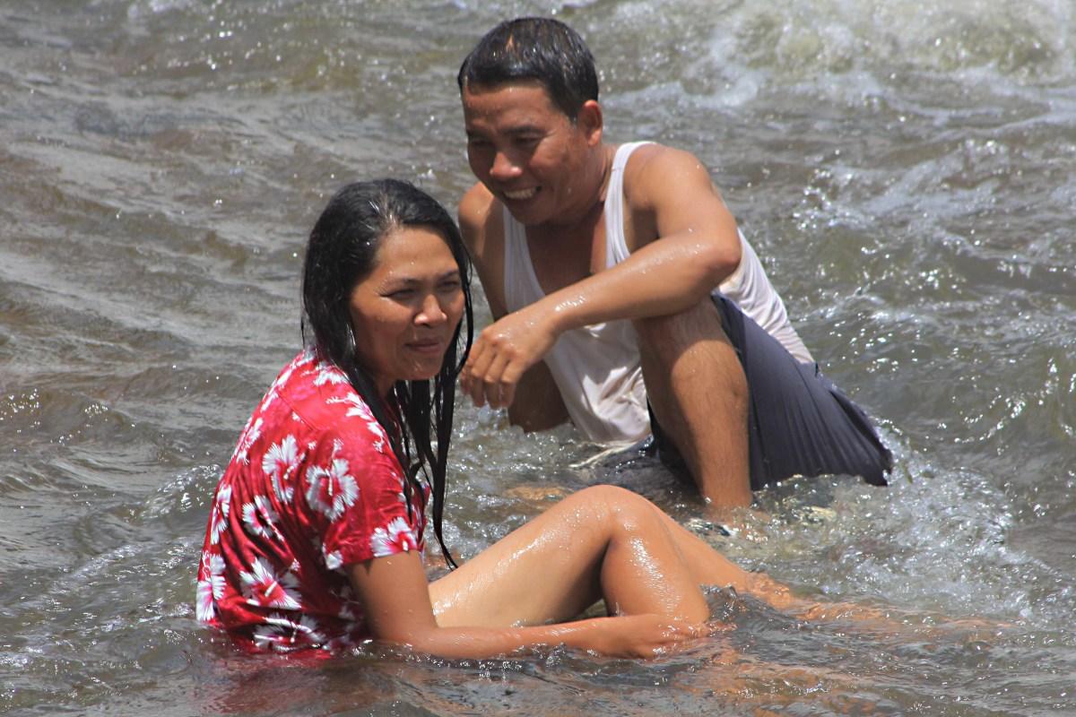 Enjoying bathing at the base of the falls