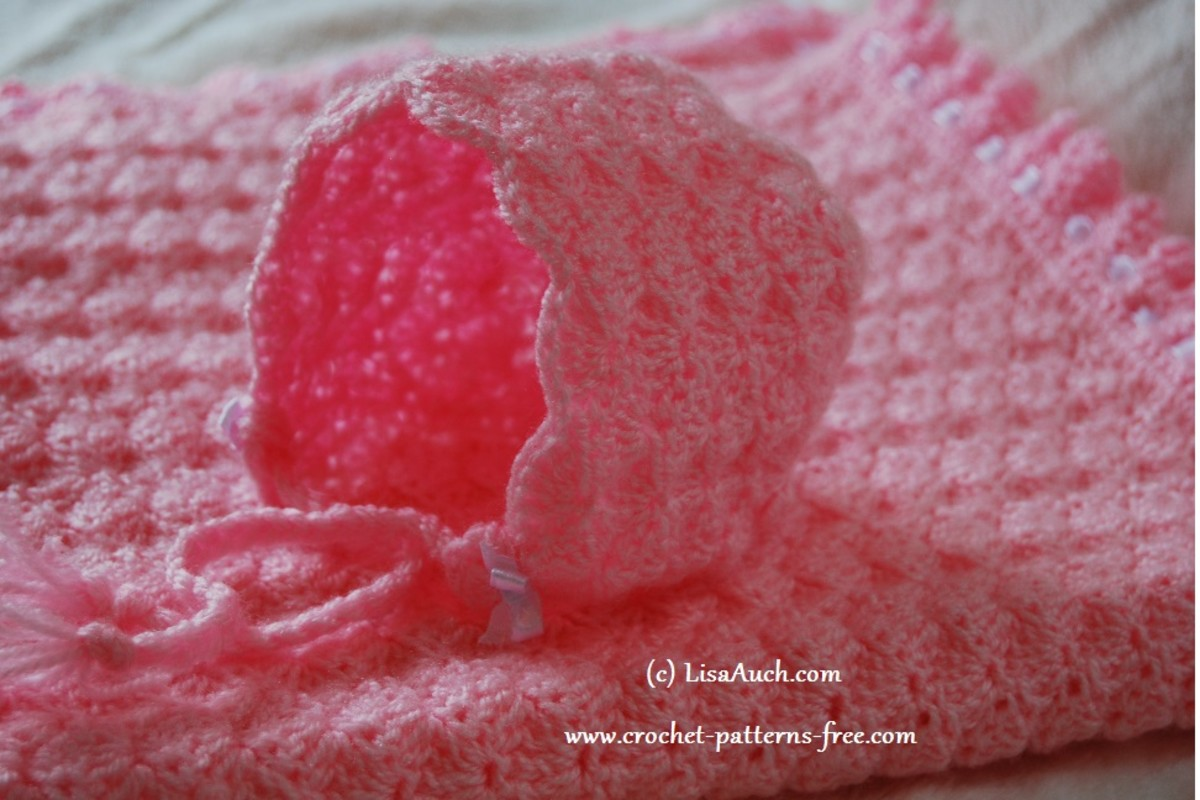 Baby bonnet shell stitch with matching blanket.