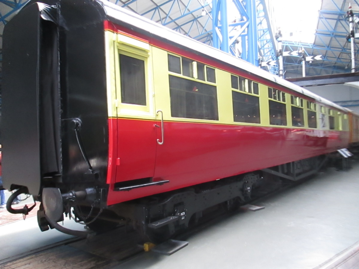 Early British Railways Mark 1 Buffet Car built at York (with Gresley LNER bogies). Carmine and cream livery with black and cream waist bands, Gill Sans lettering and numbering