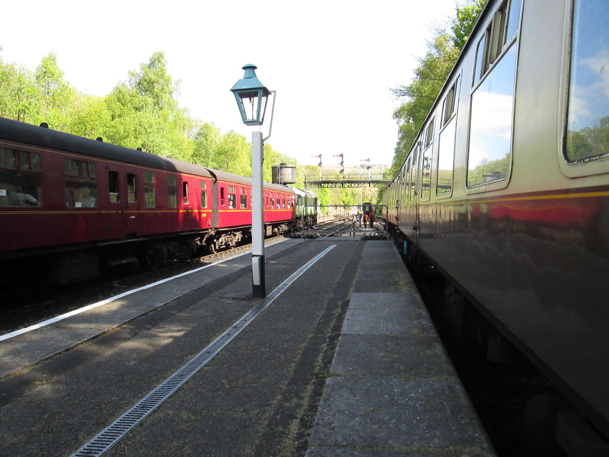 Preservation - British Railways' Mark 1 stock on a Whitby train held on the far (down) side of Grosmont Station on the North York Moors Railway. Nearside is Metro Cammell Pullman named stock with original 1920s brake 3rd