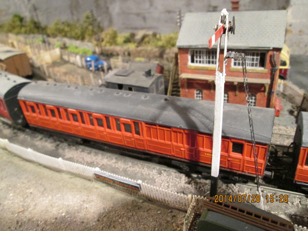 The middle coach  on this branch line working is a brake 3rd. Milk churns, parcels, mail and  general goods were carried in the brake end. Again in BR crimson, originally teak, as was...