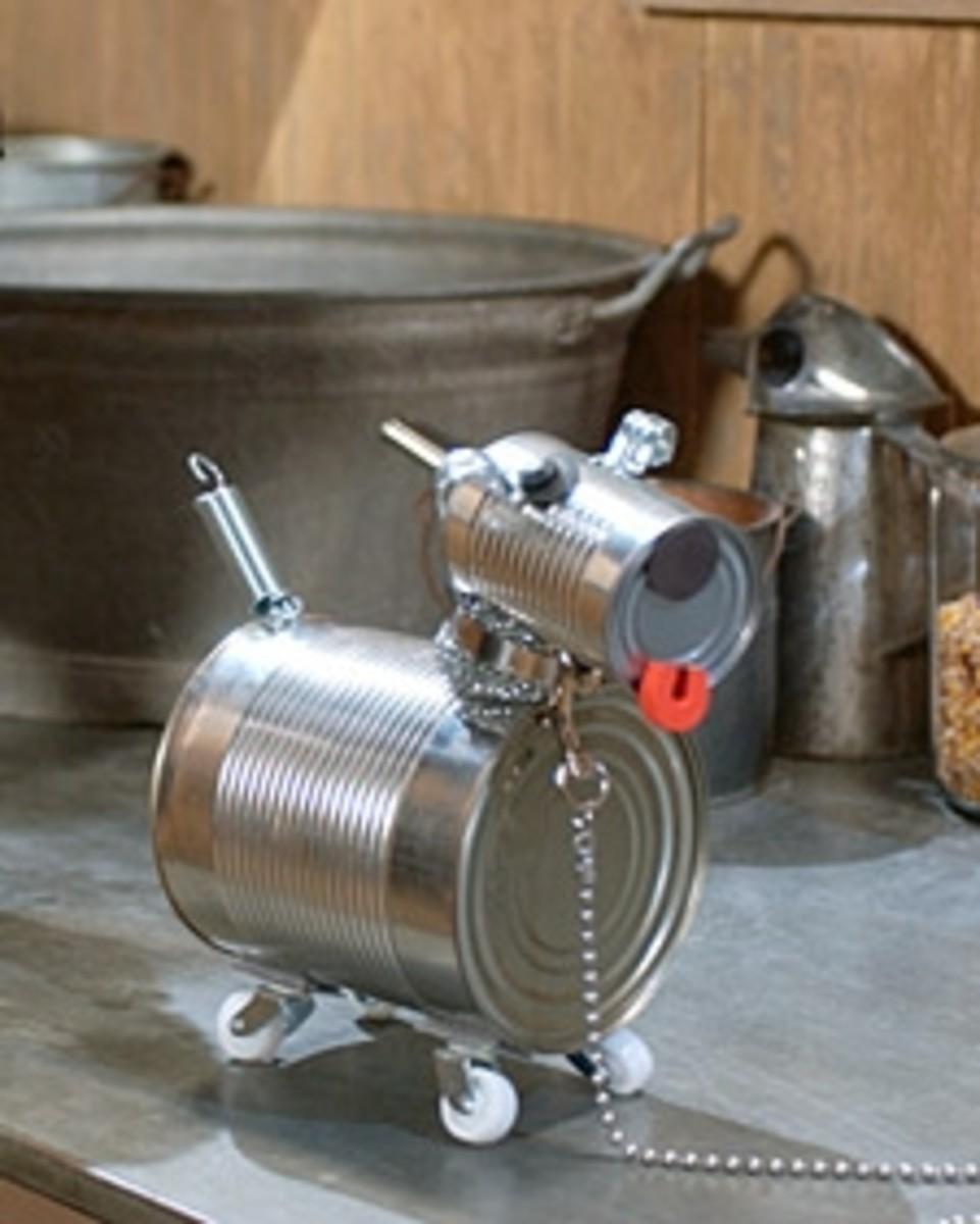 Tin Can Dog Robot. This dog was crafted from tin cans. Adorable, right?! I think so. See the link below for directions to make one (or more) for yourself! Photo Credit:  MarthaStewart.com