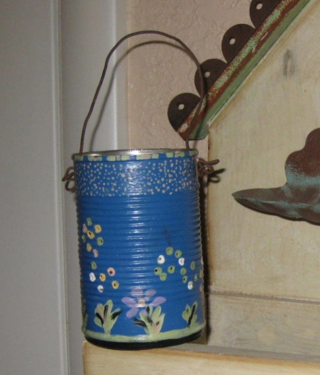 Another tin can luminary. I added a found wire hanger to this one. Photo Credit:  Peggy Hazelwood