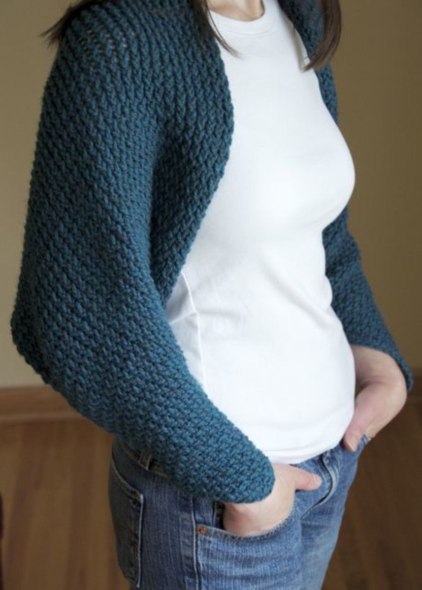 Beautiful shrug knitted on a hat loom.