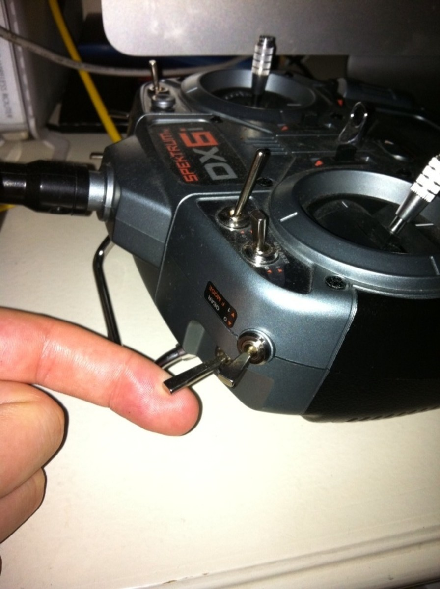 I have my finger on the Trainer Lever that will put the transmitter in Bind Mode.