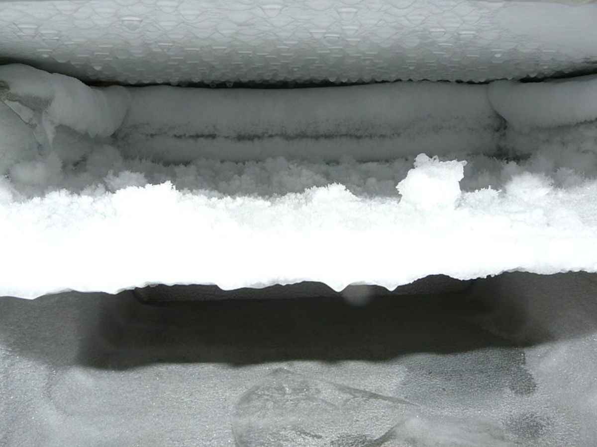 Ice buildup inside a freezer.  Currently this freezer is being defrosted.