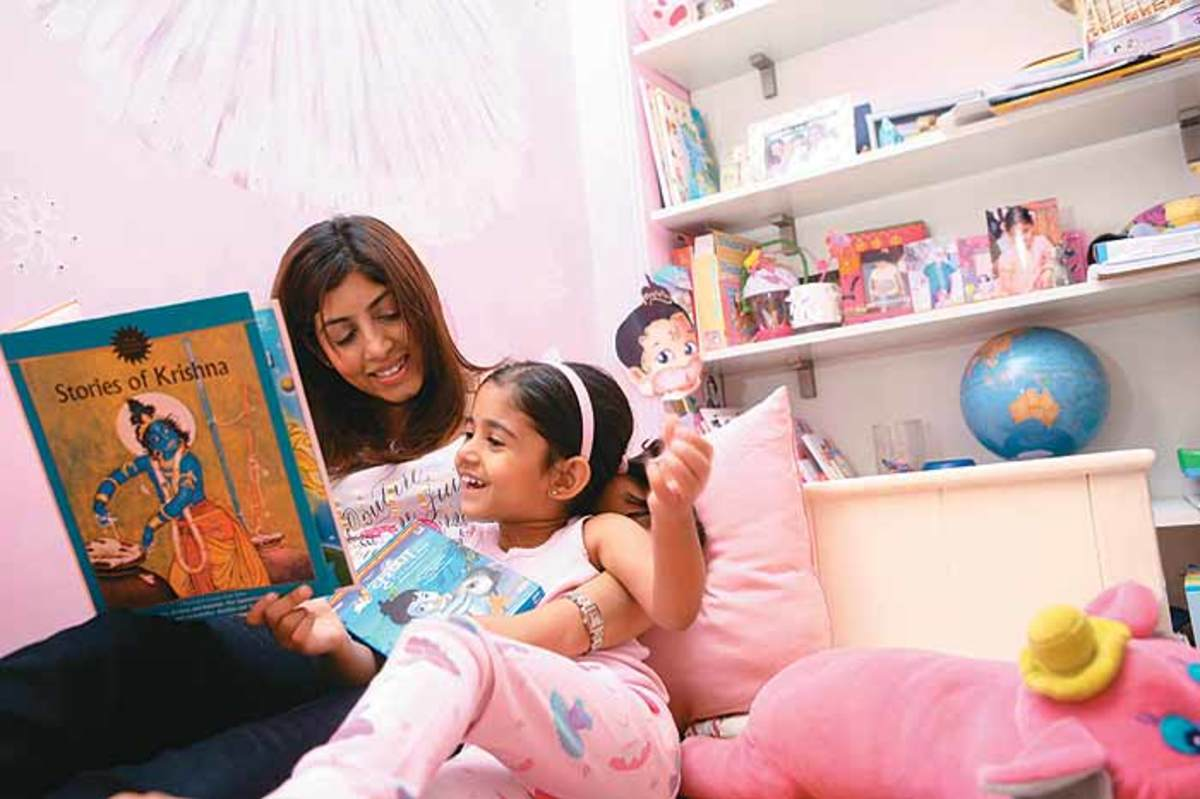 In this photo, the mother and child enjoyed reading Amar Chitra Katha comic together.