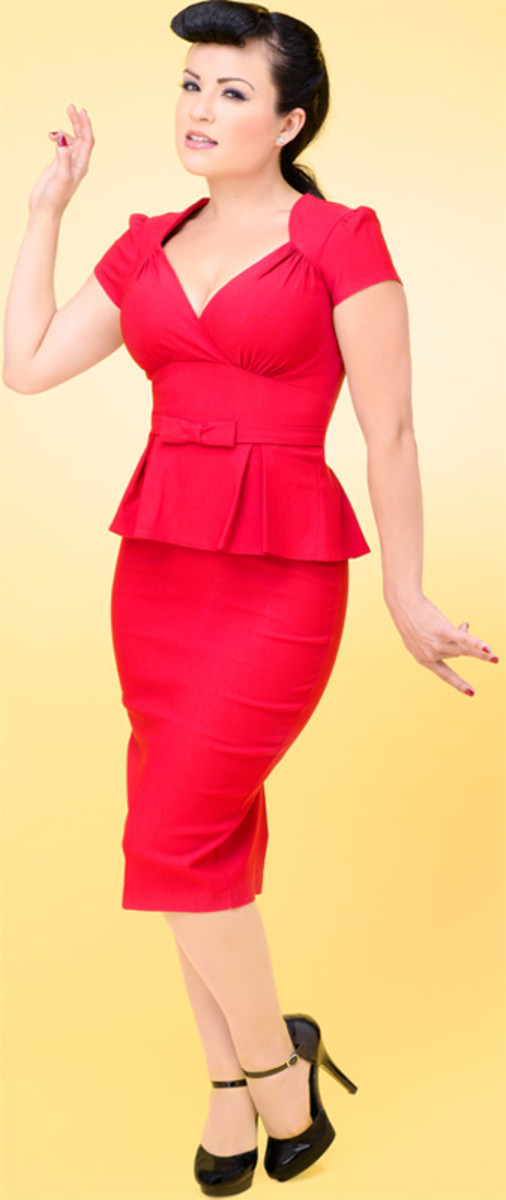 This red wiggle dress is perfect for showing off God-given curves (bust) and created ones. The wide waist detail creates a waist and the peplum adds volume to narrow hips.