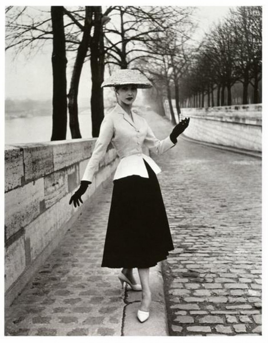 Christian Dior's 1947 New Look signaled out with the inverted triangle and in with the hourglass. Women wore corsets, girdles and petticoats to get the look.