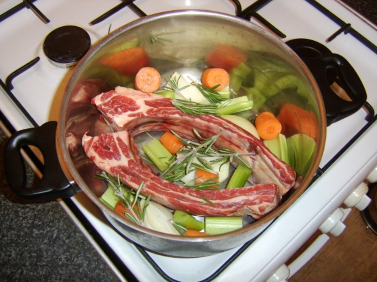 Solid ingredients for beef stock are assembled in stock pot